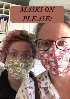 Esther and another woman wearing a face mask