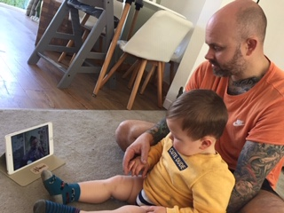 Daddy and son watching livestreams